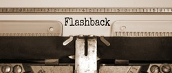 Word 'flashback' typed on retro typewriter. Sepia effect. Business concept.