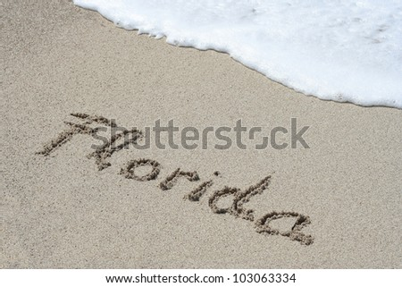 Word Florida on beach - vacation concept background