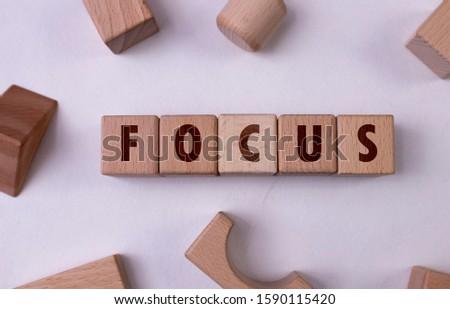 "Word ""Focus"" written with wooden blocks"