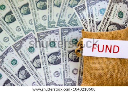 Word FUND and Savings Dollar banknote money in sack. Show growth asset investment, Retirement plan, Pension fund, 401K, Wage, Millionaire, Financial freedom, Wealth, Mutual fund, Stock market concept.