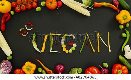 Word go vegan on a black background. Vegetables made word go vegan. Vegetables on a black background.                                 #482904865