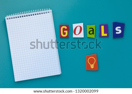 Word goals. Inscription goals. A word writing text showing concept of goal setting made of different magazine newspaper letter. Word goals on blue background #1320002099