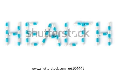 Word HEALTH made from blue white medication capsules Isolated on white background