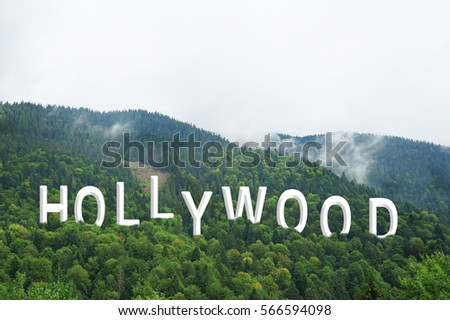 Word HOLLYWOOD on landscape background