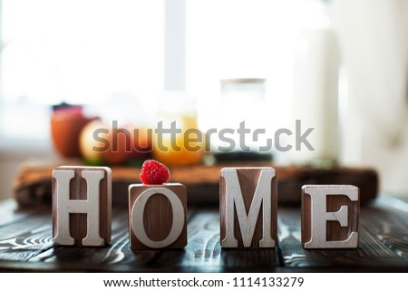 Word home of the decorative letters on wooden table #1114133279