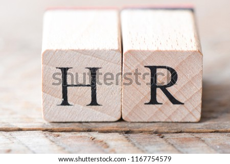 Word HR. Wooden cube block building the word HR.