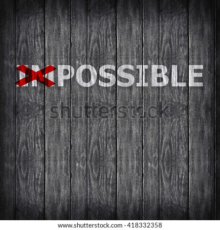 Word impossible transformed into possible on grey wall #418332358