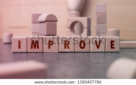 "Word ""Improve"" written with wooden blocks"
