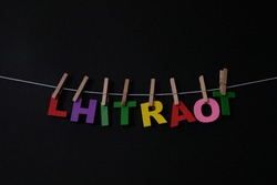 Word Lhitraot on black background. Lhitraot means good bye in Israel . Concept for art, learning, and education.