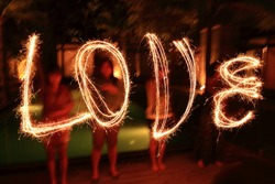 word 'LOVE' from light painting in the dark