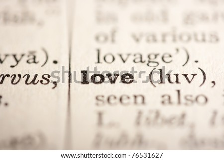 Word love from the old dictionary, a close up.
