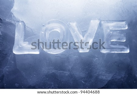 "Word ""LOVE"" made with real ice letters on ice."