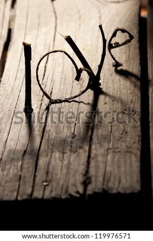 Word 'love' on a old wood planks