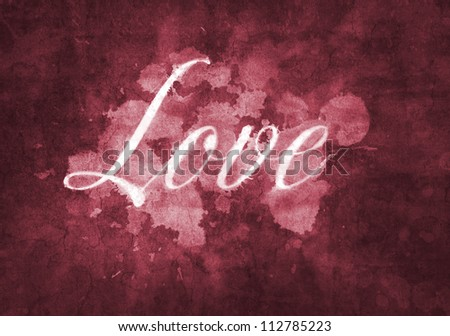 """Word """"Love"""" written in artistic script on a red background."""