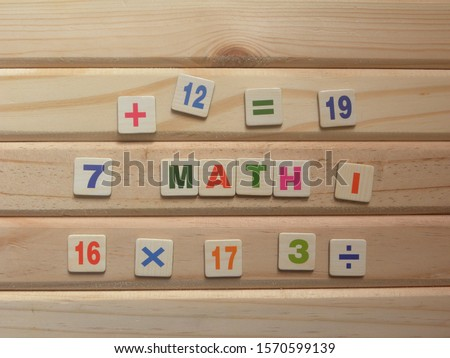 Word Math on wood background with numbers and mathematics symbols