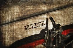 word murder written with an old typewriter