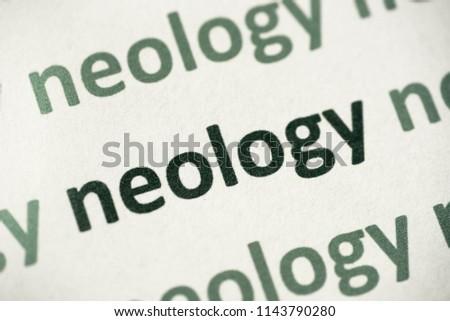 word neology printed on white paper macro