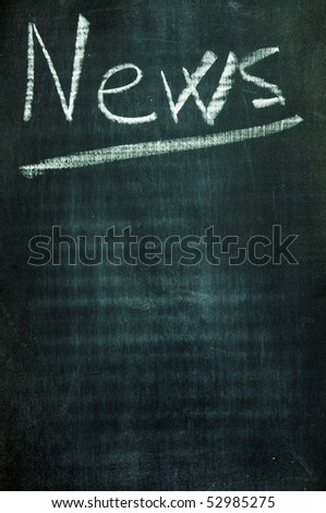 word news written with a chalk on a blackboard