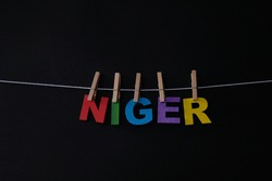 Word Niger on black background.Niger officially the Republic of the Niger, is a landlocked country in West Africa named after the Niger River.