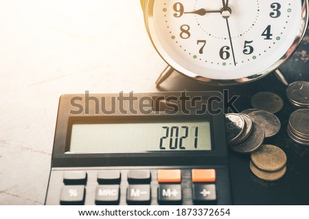 word 2021 number on a calculator. Business and tax concept. Pay tax in 2021 years. The new year 2021 tax concept