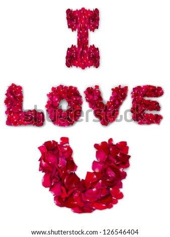 Word of love made from red rose petals on white background