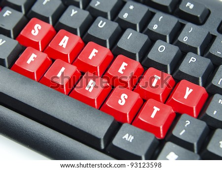 Word of safety first on red keyboard button.
