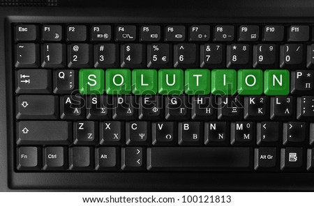 Word of solution on green  keyboard button.