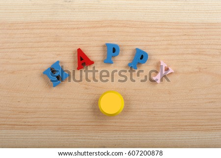 word on wooden background composed from colorful abc alphabet block wooden letters, copy space for ad text. Learning english concept #607200878