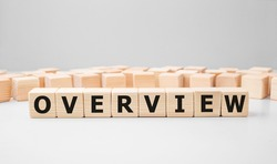 Word OVERVIEW made with wood building blocks