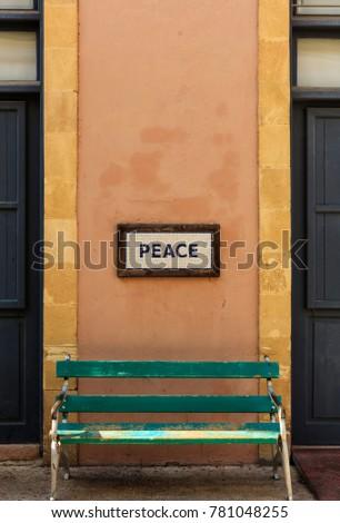 word peace framed above a...