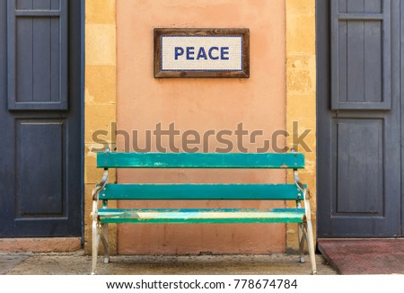 word peace framed above an old...