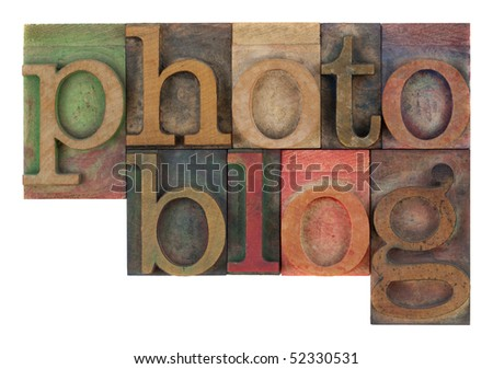 word photoblog in old letterpress wooden type blocks, stained by colorful inks,  isolated on white