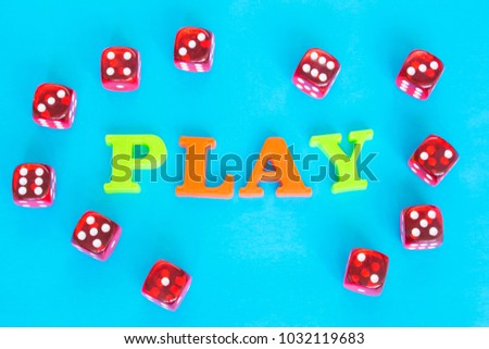 Word Play made of colorful letters and red dice on the blue background.  #1032119683
