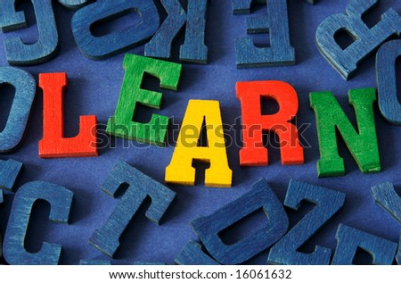 "Word ""learn"" on blue background - stock photo"