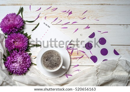 Word relax with book, cup of coffee and pink flowers. Copy space for text. greeting card