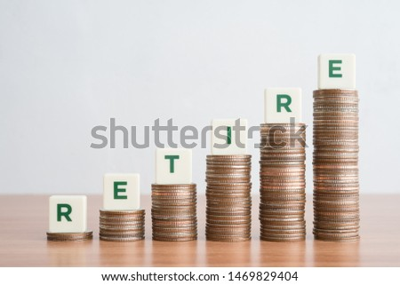 Word RETIRE on step stacked coins as graph up with white background. Money saving, investment , insurance or financial management planning for retirement concept.