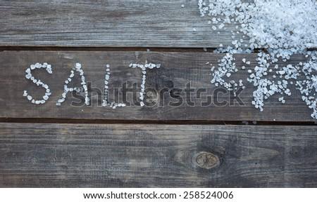 word salt written with sea salt crystals