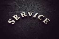 Word service written on black background