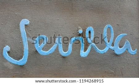 Word 'Sevilla' (Seville) in a blue sign with beautiful typography on dark background, famous destination in Spain #1194268915