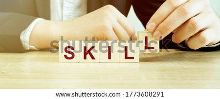 Word SKILL made with wood building blocks