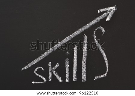 word Skills hand written on the chalkboard with rising arrow graph
