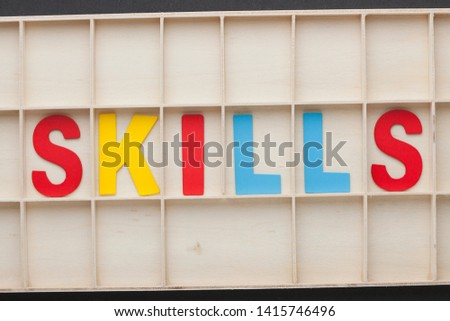 Word Skills made of colorful alphabet letters on wooden surface. #1415746496