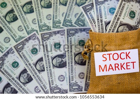 Word STOCK MARKET and Savings Dollar banknote money in sack. Show growth asset management and investment, Retirement plan, Pension fund and 401K, Wage, Millionaire, Financial freedom, Wealth concept.