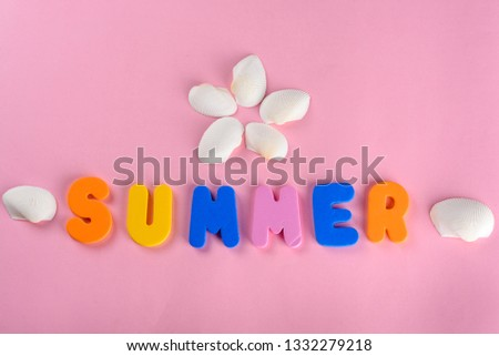 Word SUMMER letters and seashell or sea shell on pink textured background. Original idea from natural material for summer design. Flat lay. #1332279218