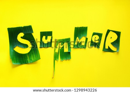 Word SUMMER letters from green tropical palm leaves on yellow textured background. Original idea from natural material for summer design #1298943226