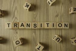 Word transition from wooden blocks on desk, development concept