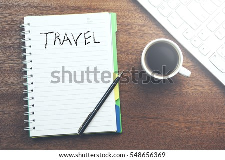 Word travel on notepad and keboard with coffee #548656369