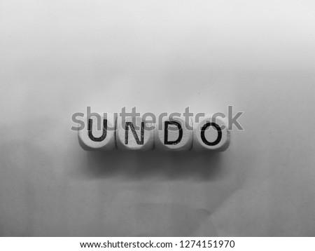 word undo spelled on dice #1274151970