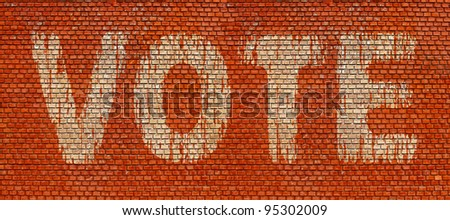 Word Vote on red brick wall background