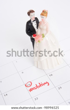 Word wedding in calendar and wedding figurines - planning a wedding concept